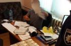 Прокуратура затримала хустського поліцейського за хабар 11500 грн