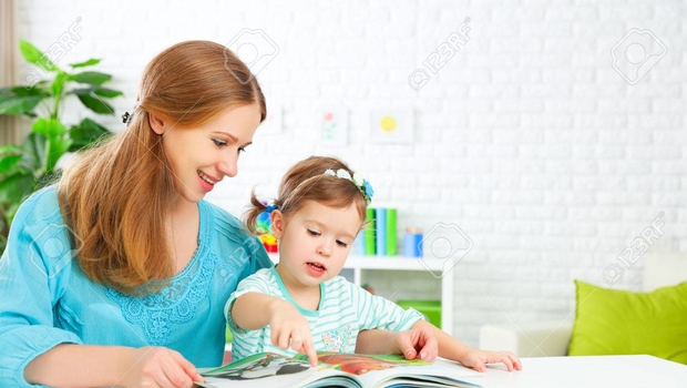 50910698-mother-and-child-reading-a-book-together-at-home