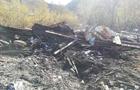 На Рахівщині залишки згорілого будинку священика скинули на берег річки