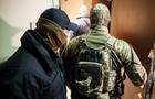 В Ужгороді проводяться обшуки у помешканні сина екс-голови Конституційного суду