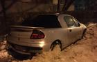 В Ужгороді снігоприбиральна машина зачепила ковшем легковик і протягнула його 50 метрів (ФОТО)